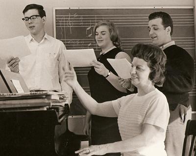 Gretchen Garnett teaching students Sandra Brown, Leonard Owens and Tom Strong in her studio on Bellflower Road in the former Blossom family house (now razed), ca. 1968.