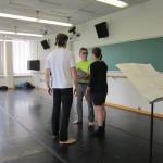 David Shimotakahara talks with dancers Noelle Cotler and Damien Highfield.