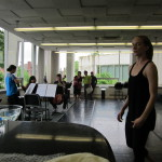 Dancers and musicians in rehearsal.