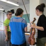 David Shimotakahara with violinists Diana Cohen (blue) and Amy Schwartz Moretti.