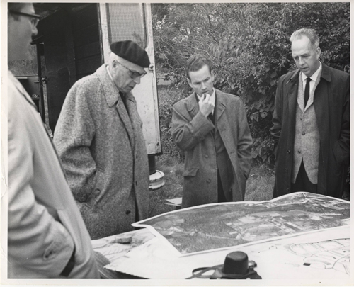 Szell and Louis Lane look at the plans