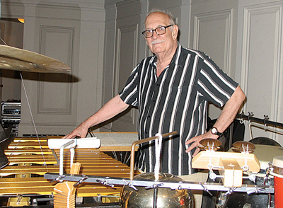 Composer George Crumb surrounded by percussion instruments