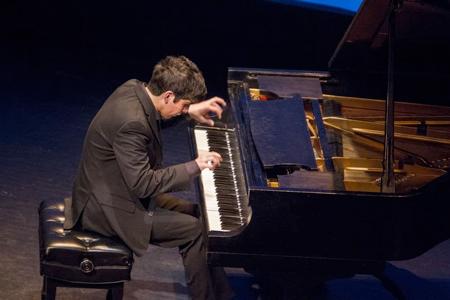 Ozel-at-Piano